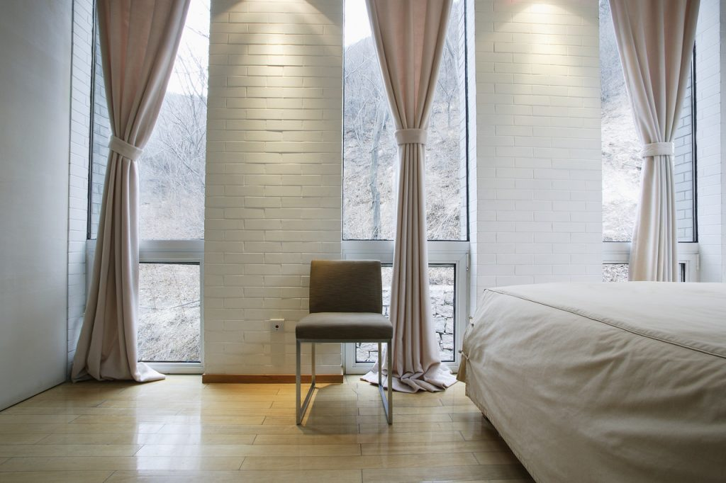Modern Bedroom in Light Tones --- Image by © Royalty-Free/Corbis